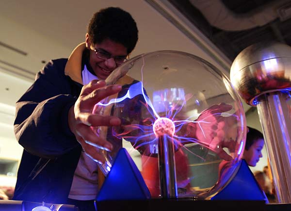 "Ethan Brown touches an ""electric ball"" after the ""Wonders of Physics"" show as part of the Science Expeditions 2007 held March 24, 2007 at the University of Wisconsin-Madison. ©UW-Madison University Communications;  Photo by: Aaron Mayes"